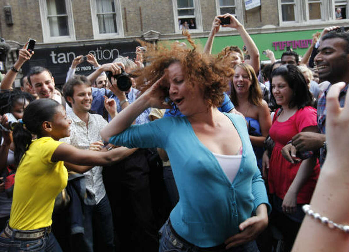 Fans dance to his tunes in central London on June 26.