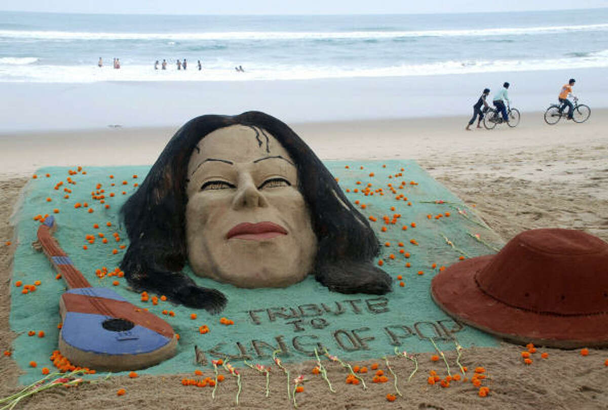 Sand sculptures honor the artist in Puri, India, on June 26.