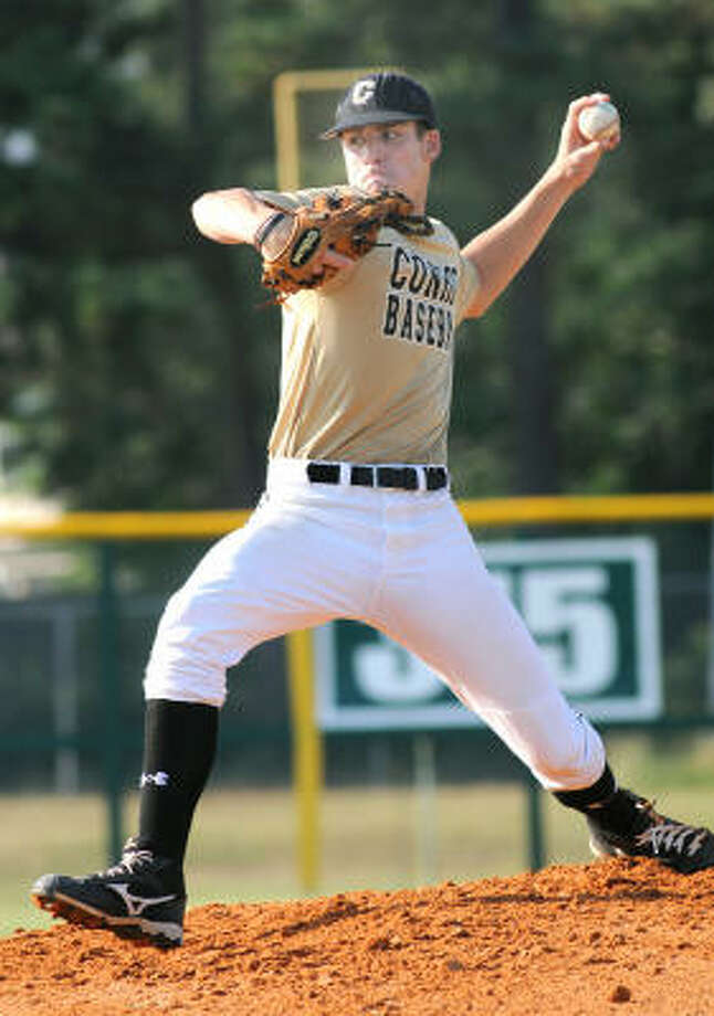 SUMMER BASEBALL:Conroe pitcher Cody Myrick is set to release a pitch during a Conroe Summer Baseball League game between Conroe and Klein Oak. Photo: Jerry Baker, For The Chronicle