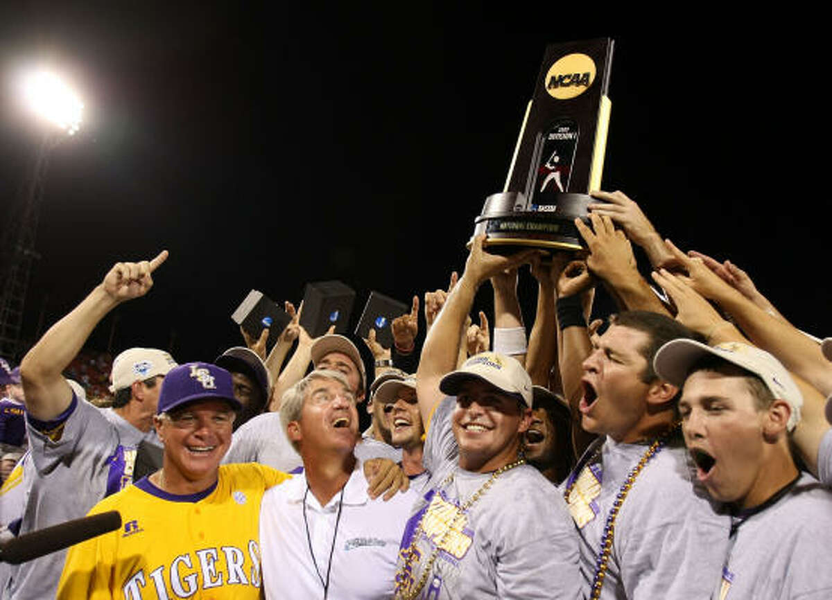 The LSU Tigers hoist the College World Series trophy in celebration of their win over Texas.