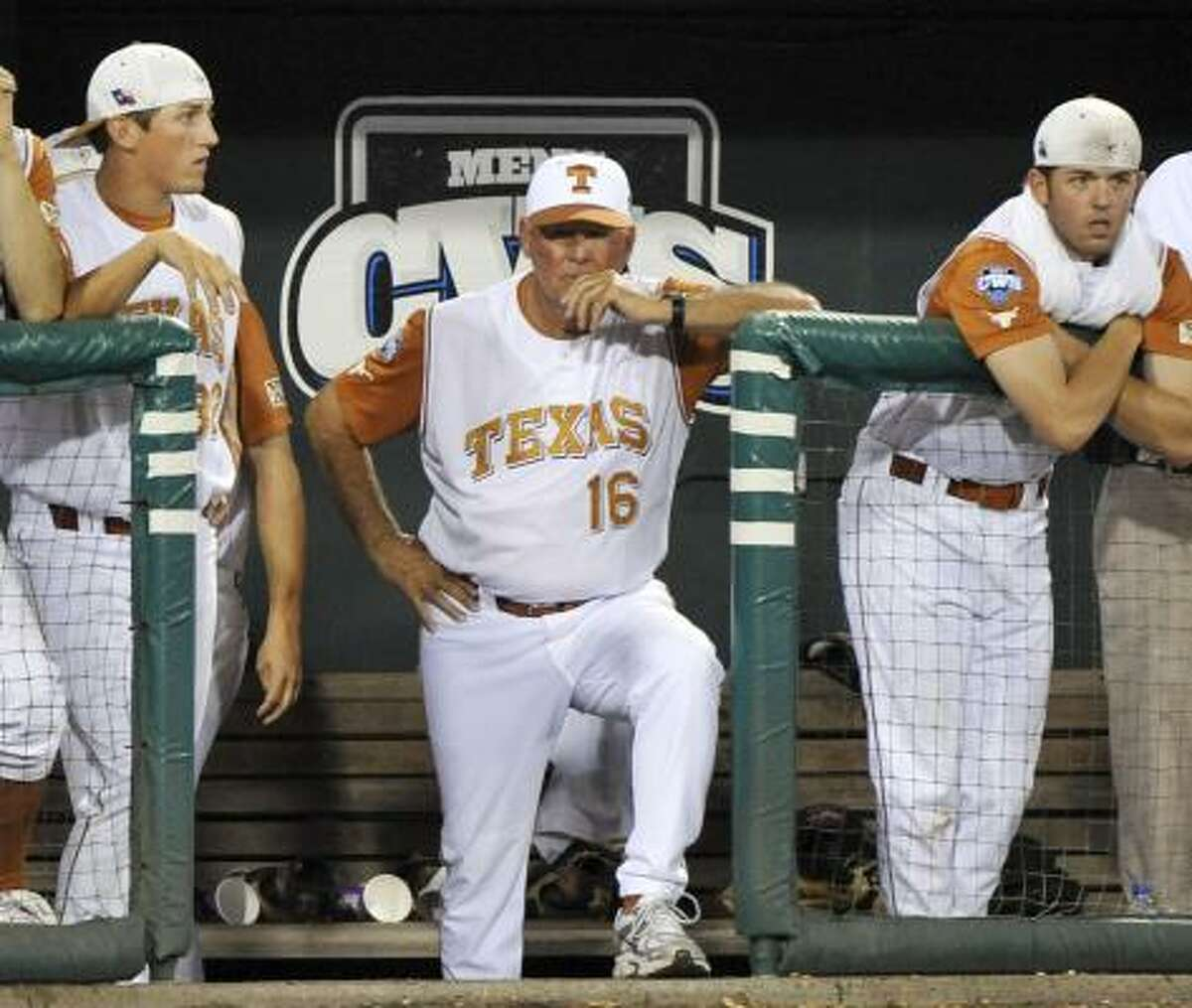 Texas coach Augie Garrido, center, along with Texas' Kendal Carrillo, left, and Austin Wood watch the last out in the game from the dugout.