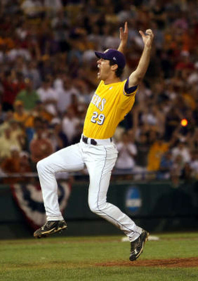 LSU pitcher Louis Coleman hurls his glove into the air and celebrates after striking out Connor Rowe for the final out of the CWS. Photo: Elsa, Getty Images