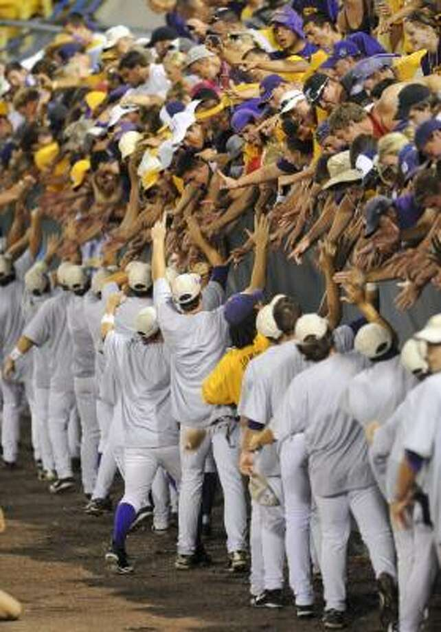 LSU players thank fans after LSU defeated Texas in Game 3 of the College World Series. Photo: Dave Weaver, AP