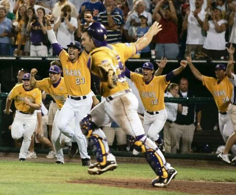 LSU players rush out of the dugout after the Tigers defeated Texas for CWS championship. Photo: Eric Francis, AP