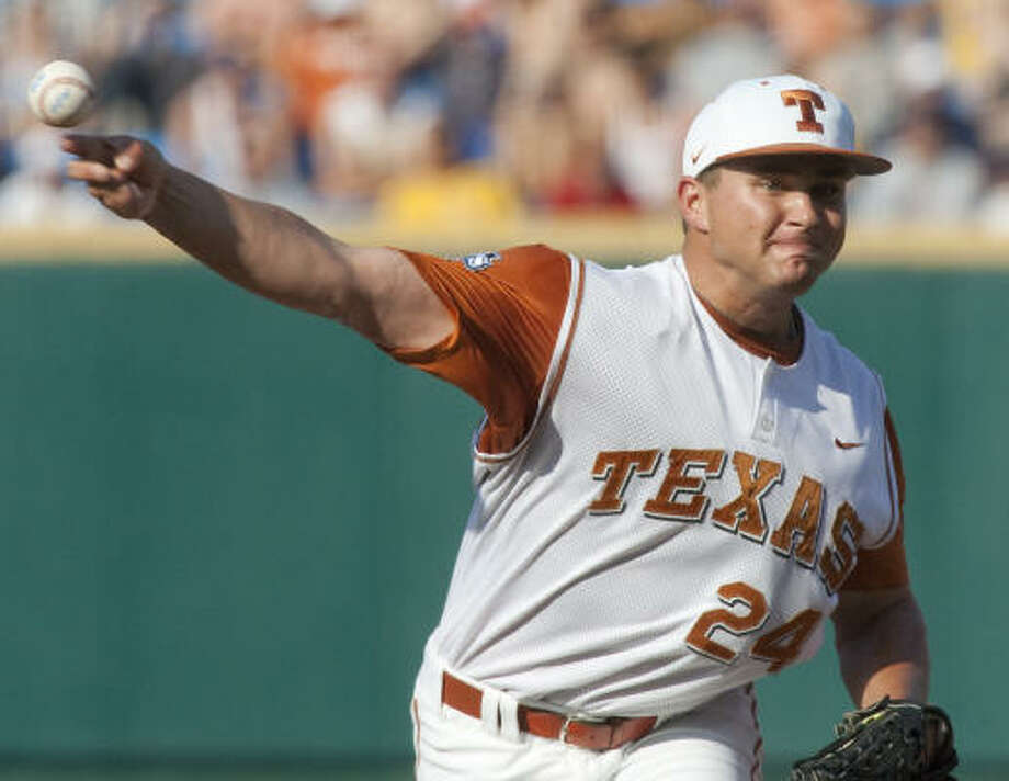 Texas starter Cole Green delivers against LSU in the first inning of the deciding game of the College World Series. Photo: Nati Harnik, AP