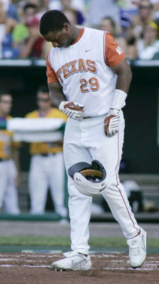 Texas' Kevin Keyes shows frustration after being struck out by LSU pitcher Anthony Ranaudo to end the first inning. Photo: Eric Francis, AP