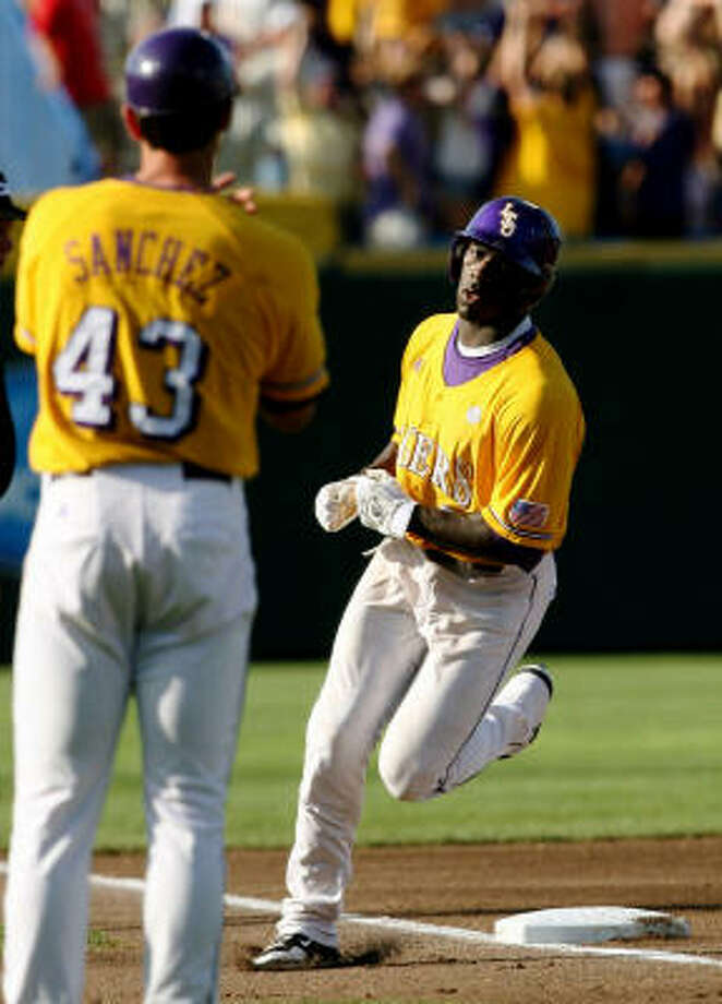 LSU's Jared Mitchell rounds third base after hitting a three-run homer in the first inning off Texas pitcher Cole Green. Photo: Elsa, Getty Images