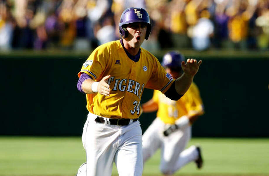 LSU's Blake Dean celebrates while he comes in to score on a three-run homer hit by teammate Jared Mitchell in the first inning. Photo: Elsa, Getty Images