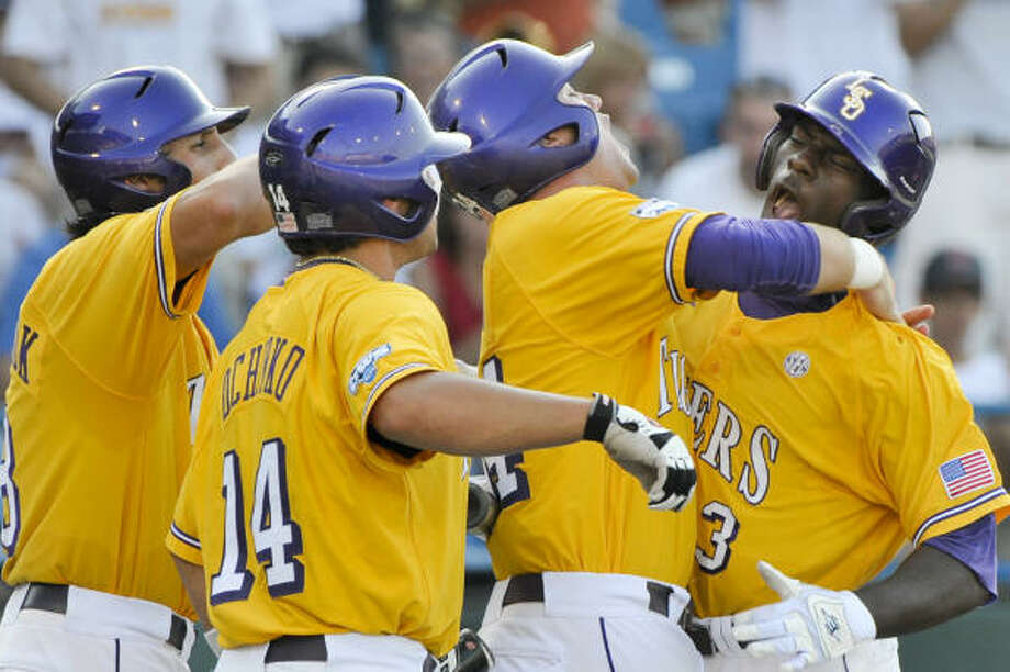LSU's Jared Mitchell, right, celebrates with teammates Blake Dean, second from right, Sean Ochinko (14) and Mikie Mahtook, left, after his first-inning three-run homer. Photo: Ted Kirk, AP