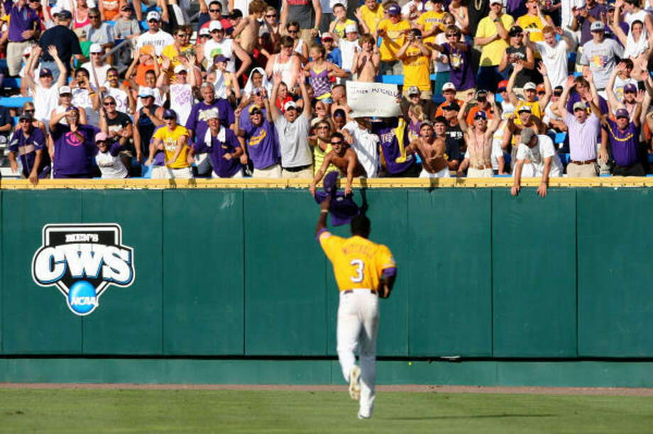 LSU's Jared Mitchell is greeted by fans as he returns to right field the second inning after his three-run homer in the first. Photo: Elsa, Getty Images