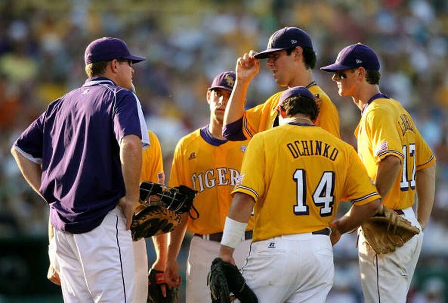 LSU starter Anthony Ranaudo, center, has a meeting at the mound after walking two Texas hitters in the third inning. Photo: Elsa, Getty Images