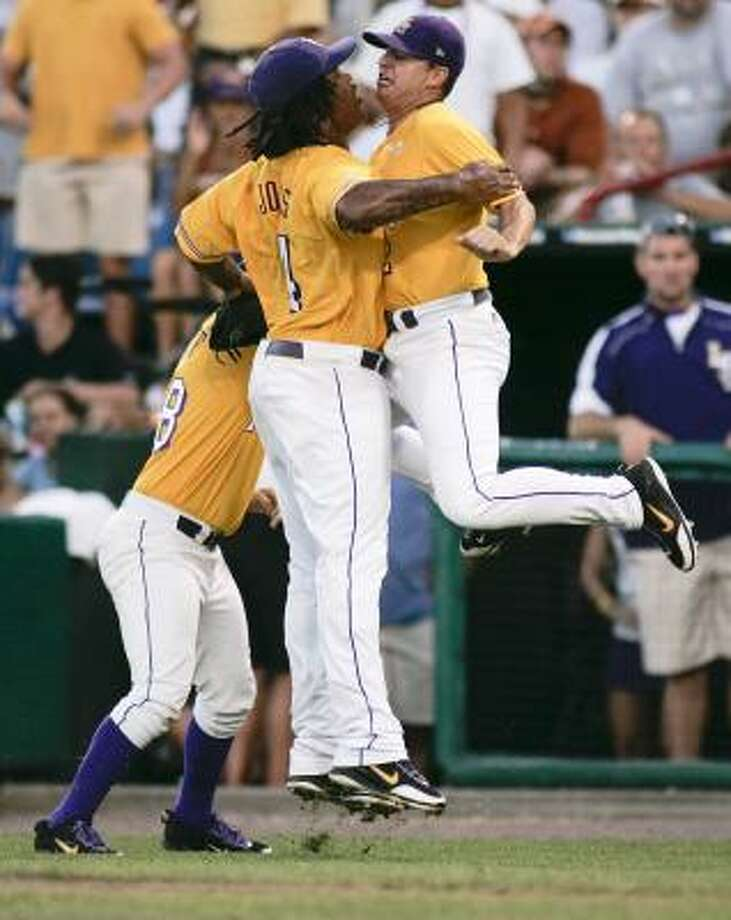 LSU pitcher Chad Jones, left, and teammate Buzzy Haydel celebrate after Jones struck out Texas' Russell Moldenhauer to end the sixth inning. Photo: Eric Francis, AP