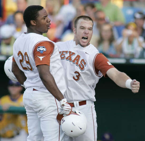Texas' Kevin Keyes, left, celebrates with Cameron Rupp after Keyes hit a two-run homer to tie the ga