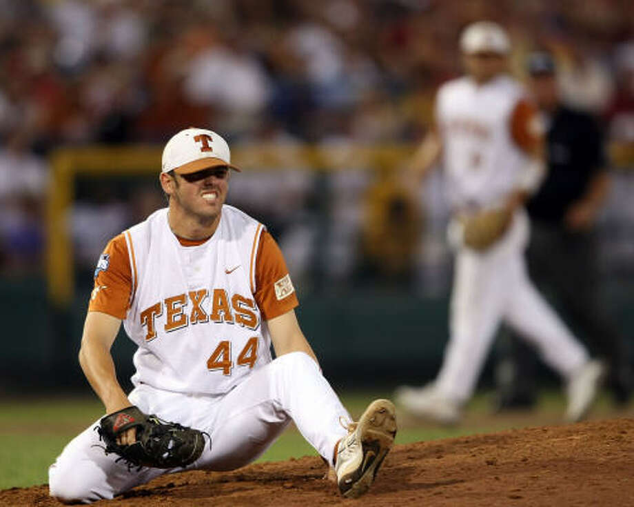 Texas pitcher Austin Wood winces after getting hit by a ball against LSU. Photo: Elsa, Getty Images