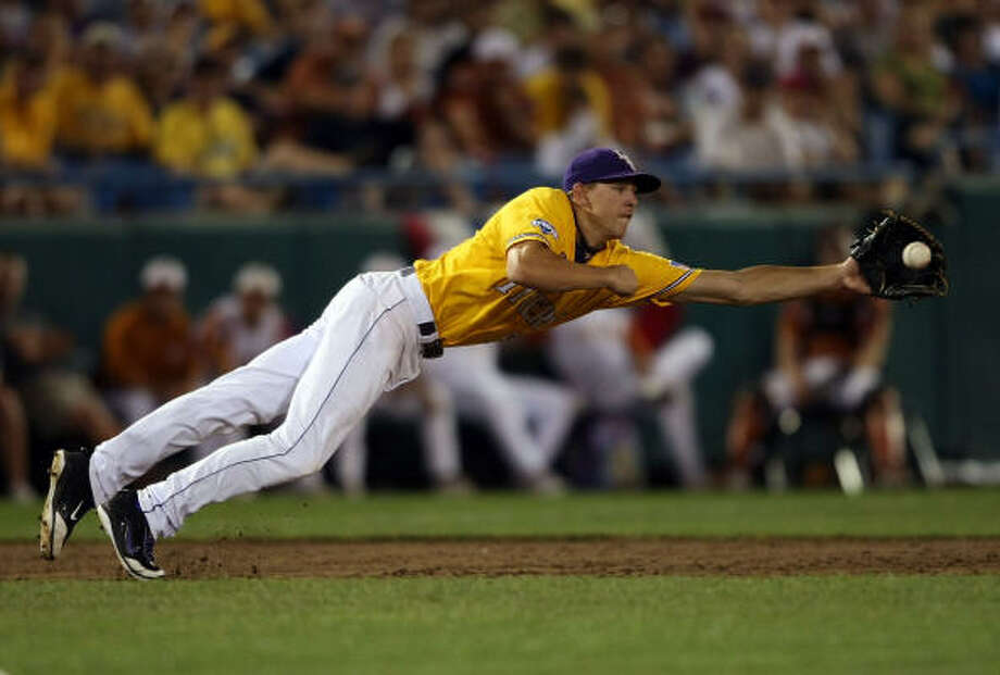 LSU third baseman Derek Helenihi makes the diving catch for the out against Texas. Photo: Elsa, Getty Images