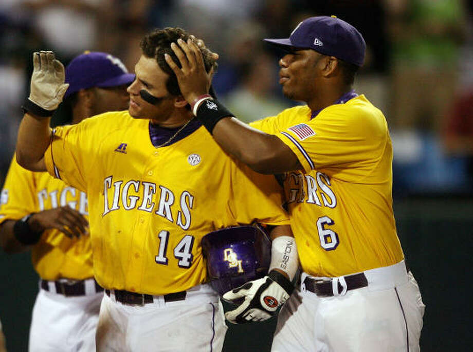 LSU's Sean Ochinko is congratulated by teammate Leon Landry after Ochinko hit a solo home run against Texas in the ninth inning. Photo: Elsa, Getty Images