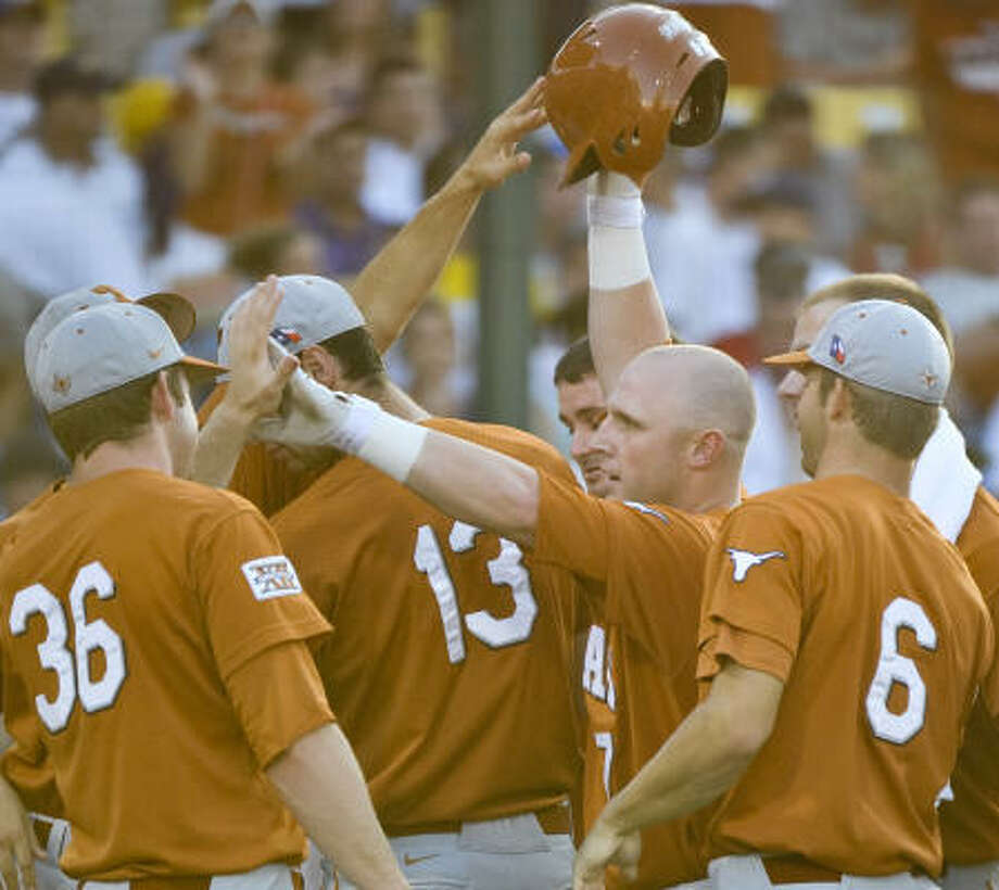 Texas' Preston Clark, second from right, celebrates his home run against LSU in the second inning. Photo: Ted Kirk, AP