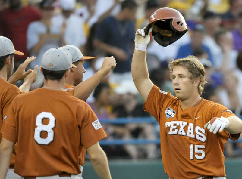 Texas' Russell Moldenhauer, right, celebrates his home run against LSU in the third inning.