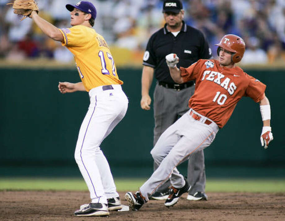 Texas' Connor Rowe beats the throw to LSU second baseman DJ LeMahieu on a double that scored Cameron Rupp in the third inning. Photo: Eric Francis, AP