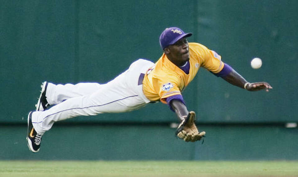 LSU right fielder Jared Mitchell lays out for, but misses, a double hit by Texas' Cameron Rupp in th