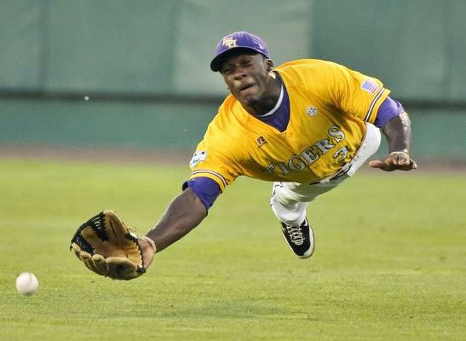 LSU right fielder Jared Mitchell can't reach a double off the bat of Texas' Cameron Rupp in the third inning. Photo: Ted Kirk, AP