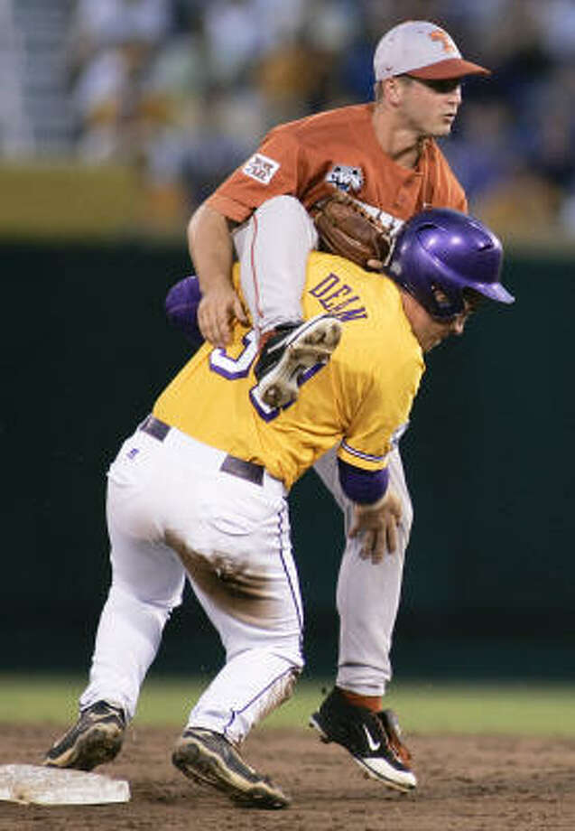 Texas second baseman Travis Tucker lands on LSU's Blake Dean after forcing him out at second base in the third inning. Photo: Eric Francis, AP