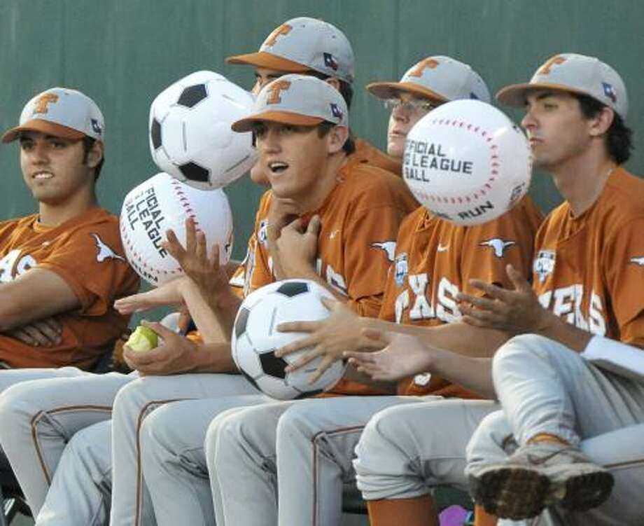 The Longhorns' bullpen bounce beach balls that fell from the bleachers in the third inning. Photo: Ted Kirk, AP
