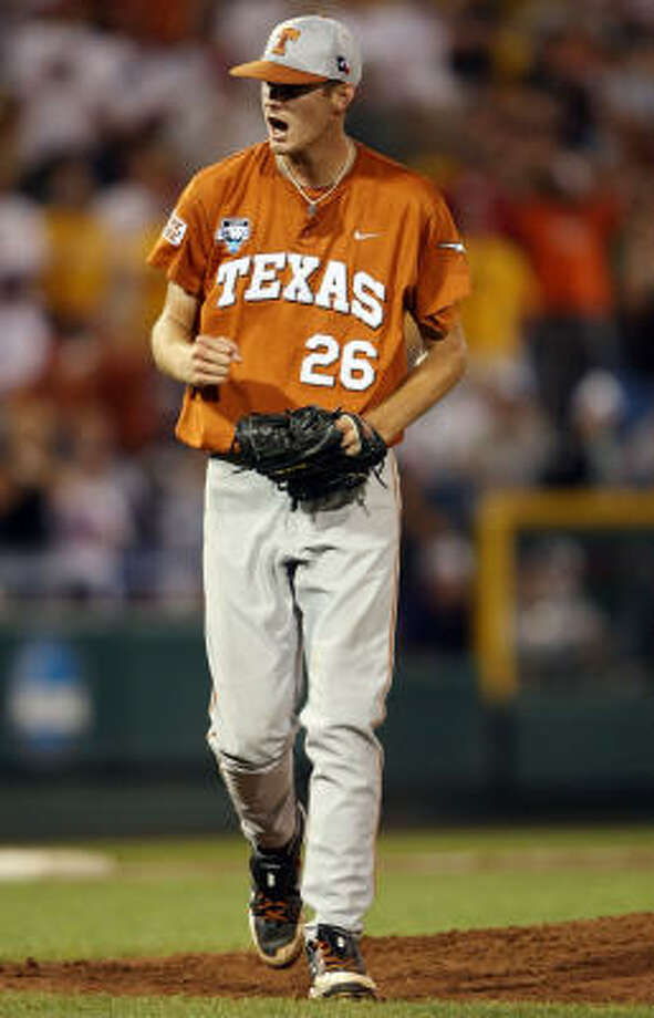 Texas starter Taylor Jungmann celebrates the win after striking out the last LSU batter. Photo: Elsa, Getty Images