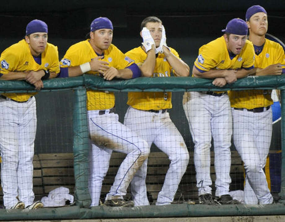 LSU's players, including Derek Helenihi, center, watch the last out against Texas in the ninth inning of Game 2. Photo: Ted Kirk, AP