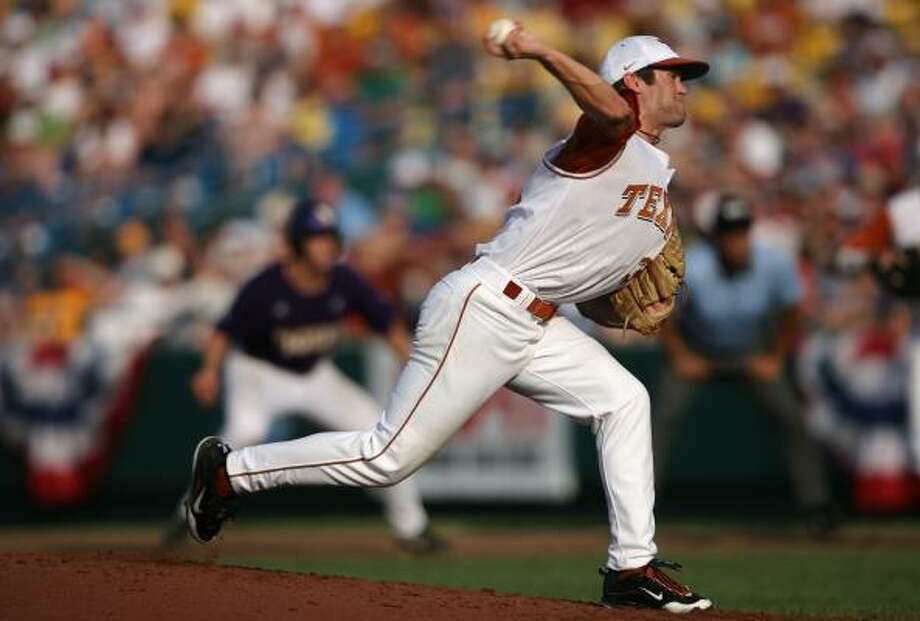 Texas starter Chance Ruffin pitches with a runner on first base against LSU. Photo: Elsa, Getty Images