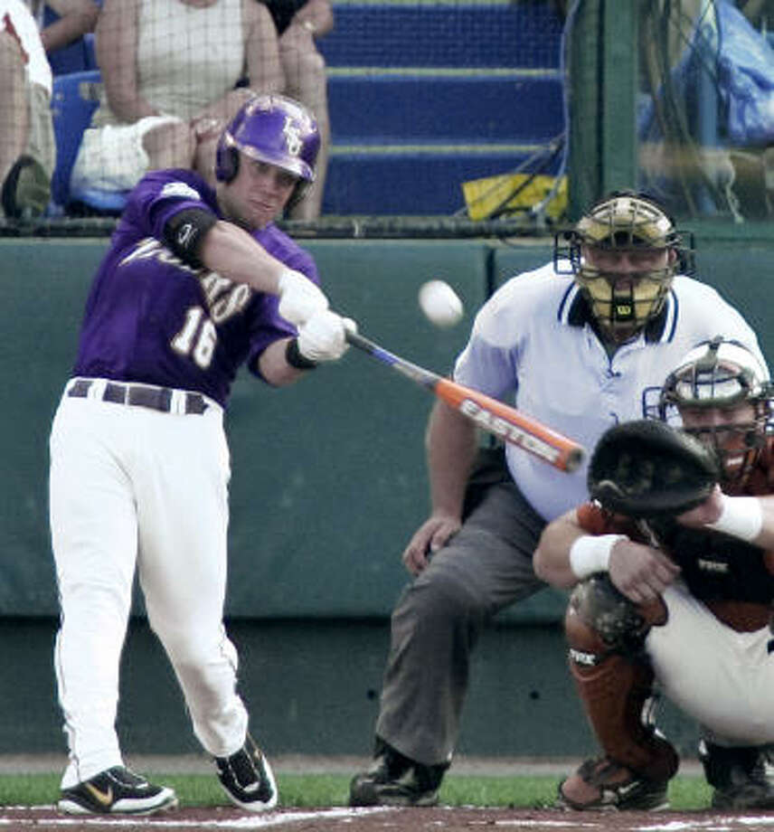 LSU's Ryan Schimpf hits a solo homer in the first inning. Photo: Nati Harnik, AP