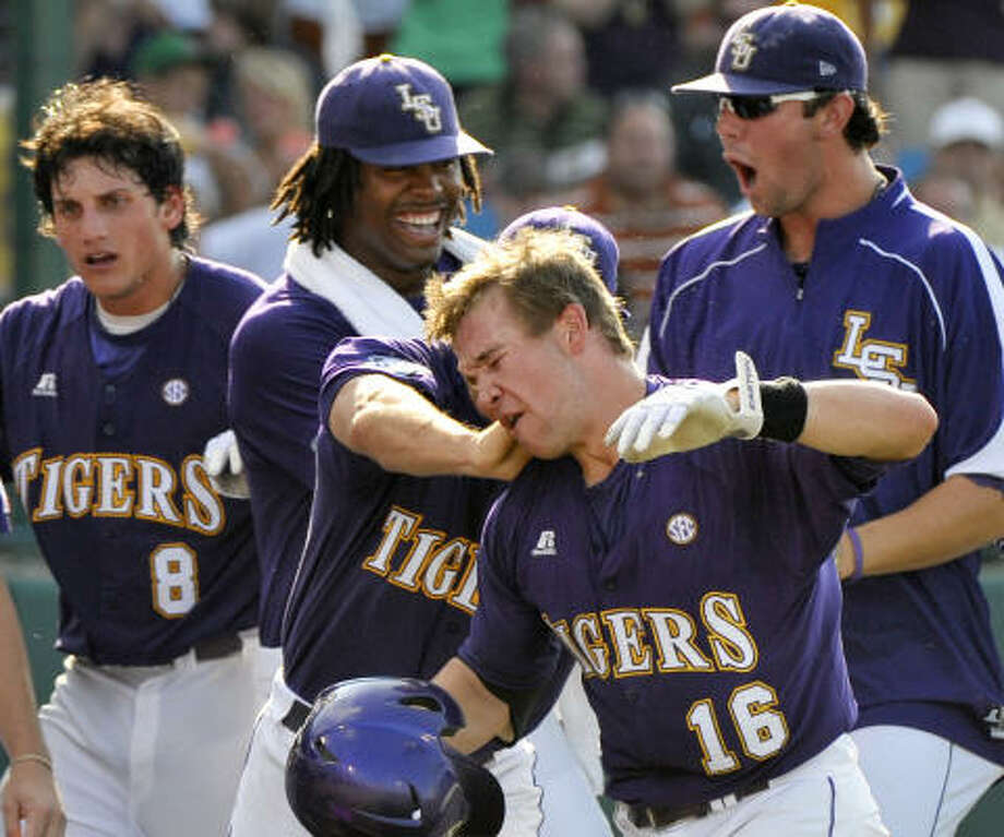 LSU players congratulate Ryan Schimpf (16), after he hit a solo homer in the first inning. Photo: Ted Kirk, AP