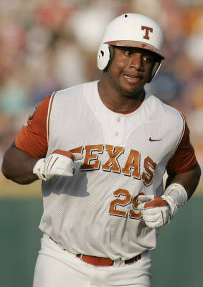 Texas' Kevin Keyes rounds the bases after his fourth-inning solo homer. Photo: Eric Francis, AP