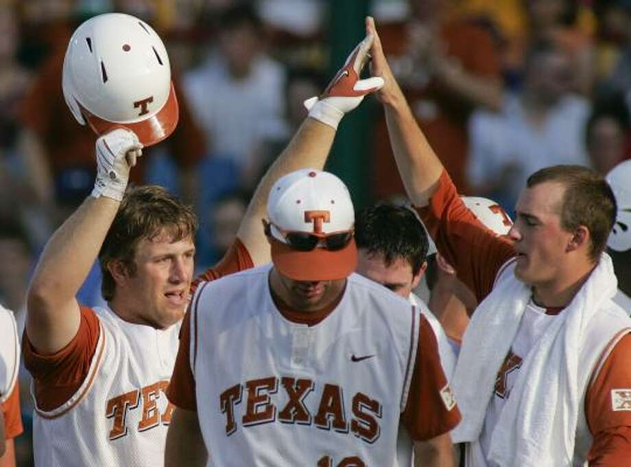 Texas players congratulate Russell Moldenhauer, left, after he hit a solo home run against in the fourth inning. Photo: Eric Francis, AP