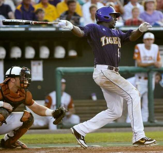 LSU's Jared Mitchell follows through on his RBI triple in the sixth inning.