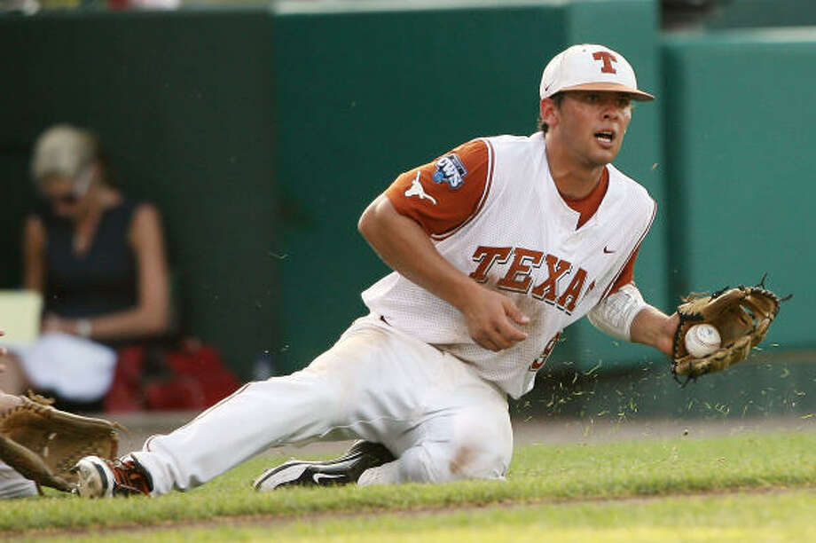 Texas third baseman Michael Torres stops a errant throw against LSU. Photo: Elsa, Getty Images