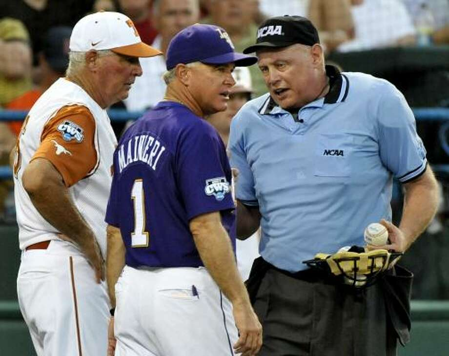 Texas coach Augie Garrido, left, and LSU coach Paul Mainieri talk with with home-plate umpire Tony Maners in the eighth inning. Photo: Ted Kirk, AP