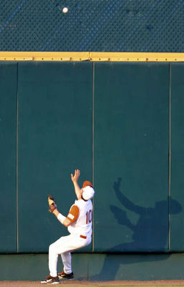 Texas center fielder Connor Rowe watches a home-run ball off the bat of LSU's DJ LeMahieu go over the wall in the seventh inning. Photo: Dave Weaver, AP