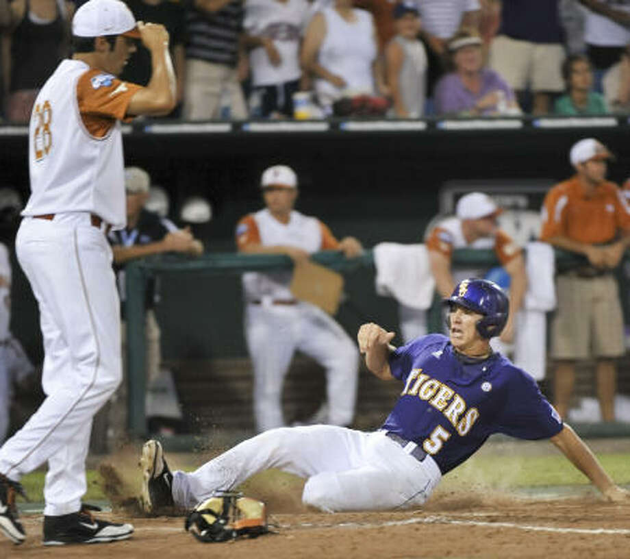 LSU's Derek Helenihi scores on a two-run single by DJ LeMahieu against Texas in the ninth inning. Photo: Ted Kirk, AP