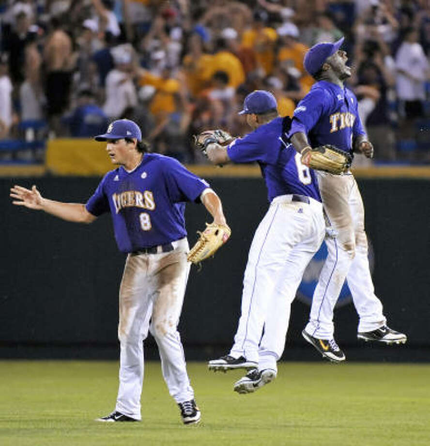 LSU's Mikie Mahtook, left, Leon Landry and Jared Mitchell, right, celebrate after LSU defeated Texas 7-6 in 11 innings in Game 1. Photo: Ted Kirk, AP