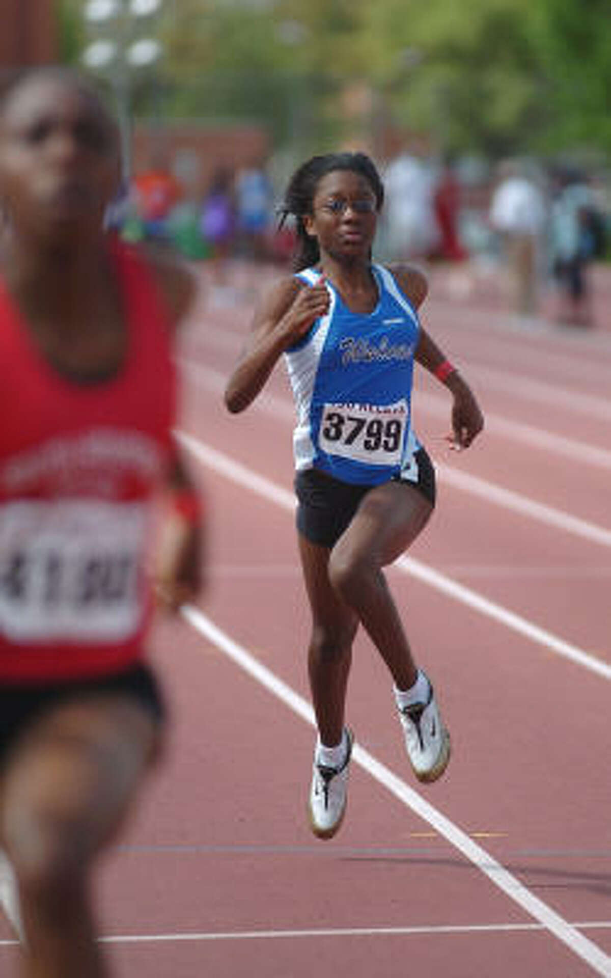 TSU Relays: Asia Davis of Westside High runs in the 100-meter event during the 56th Annual TSU Relays at Texas Southern University. .