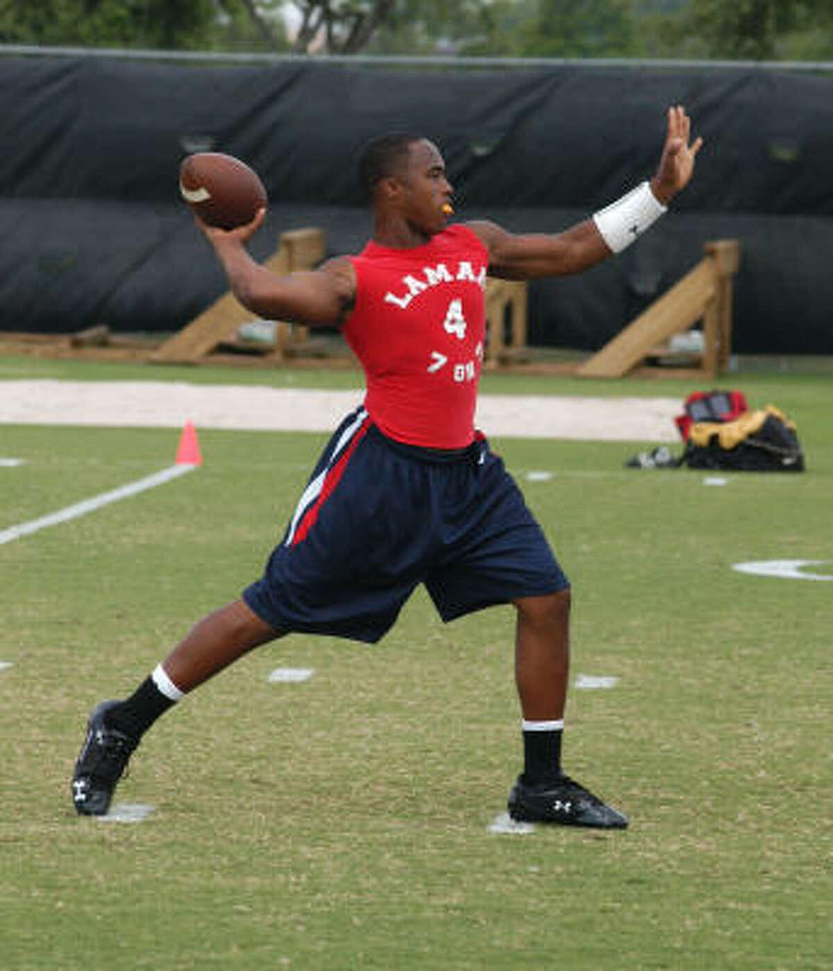 Lamar sophomore quarterback Darren Ervin sets up to pass.