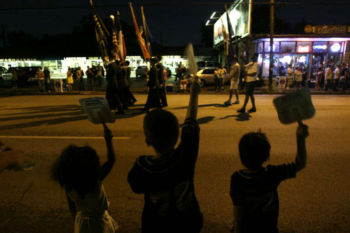 Children jump and yell as the Houston Pride Parade begins in Montrose in 2007.