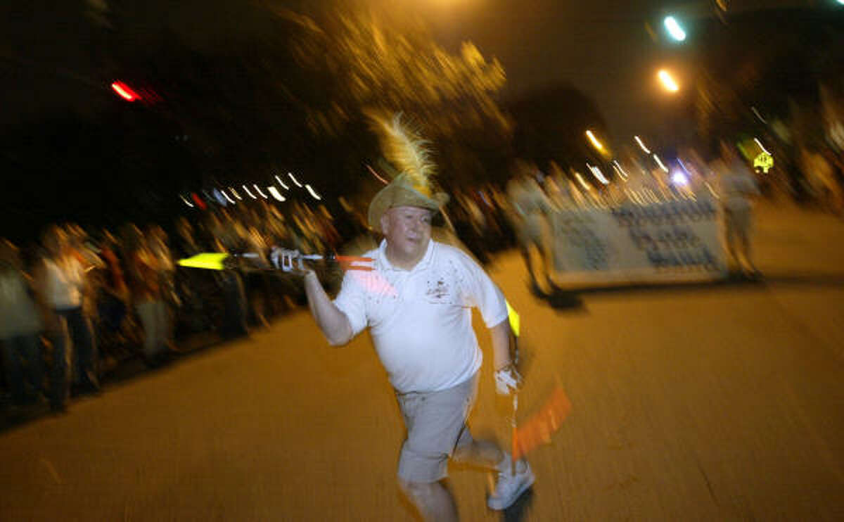 A baton-twirler leads the Houston Pride Band down Westheimer in 2007.