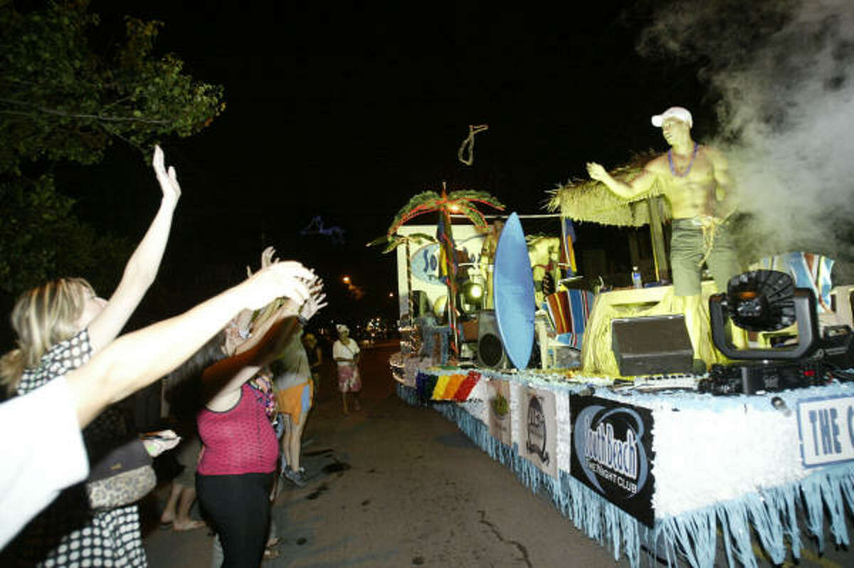 The South Beach night club float drives down Westheimer.