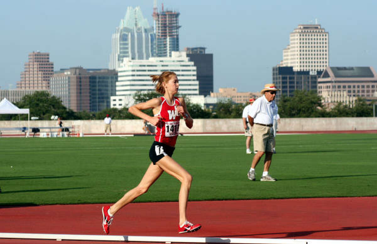 Sarah Andrews of The Woodlands on her way to victory in the 3,200 meters at the Class 5A state track and field meet. Andrews ran her way to gold in the 3200 ( 10:26.42) and the 1600 (4:56.11) meters.