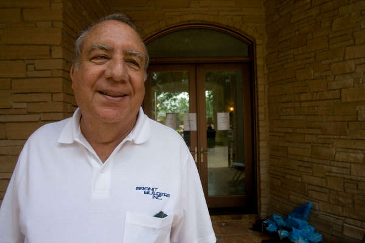 Marvin Granit greets visitors at the Granit Builders custom home at 5116 Valerie.