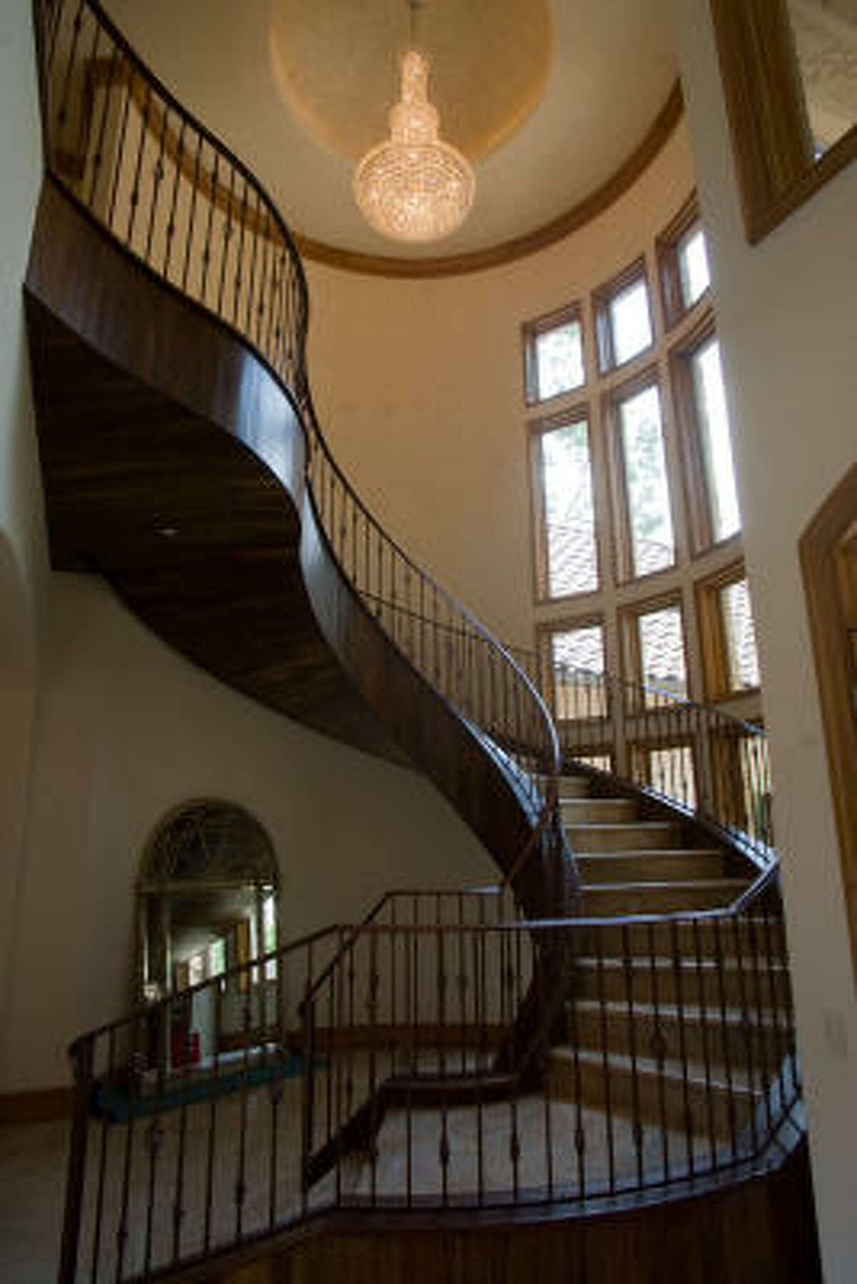 Main staircase with crystal chandelier at the Granit Builders custom home at 5116 Valerie.
