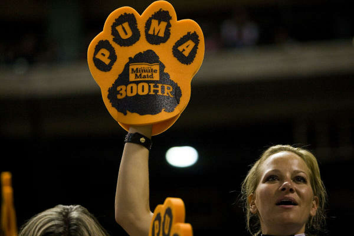 Fans show off their puma paws, given away before a ceremony celebrating Lance Berkman's 300th career home run.