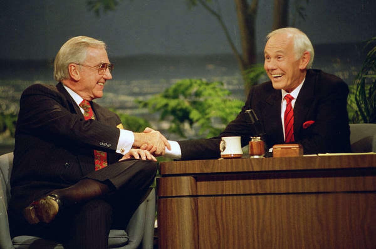 In this May 22, 1992, file photo, Ed McMahon, left, shakes hands with talk show host Johnny Carson during the final taping of the